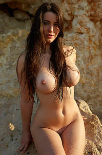 Sexy Busty Girl Posing At The Rocks